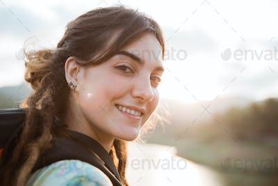 caucasian woman looking turn back looking camera