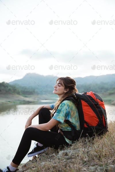 portrait caucasian woman alone sitting side lake
