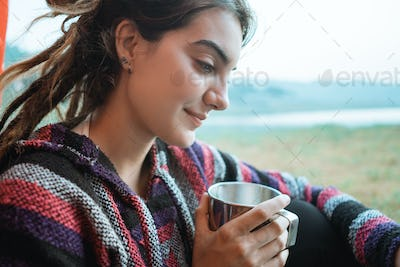 close up a woman drink a cup of coffee after wake up