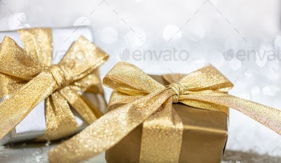 Christmas gift boxes on abstract bokeh lights and glitter background
