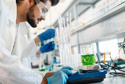 Attractive student of chemistry working in lab