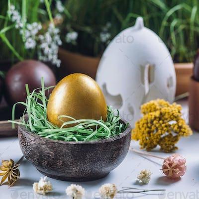 Golden Easter Egg In Wooden Nest
