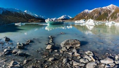 Tasman Glacier Lake with icebergs and mountains, Aoraki Mount Co