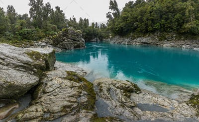 Blue water and rocks of the Hokitika Gorge Scenic Reserve, South