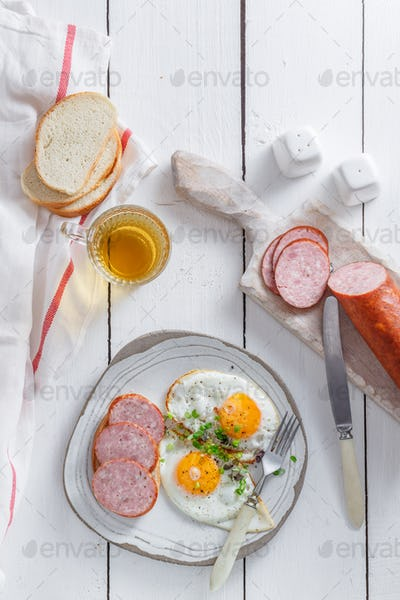 Sunny side up eggs with sausage and toast