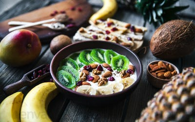 Yogurt with different fruits on a wooden background. Useful food, diet, organic