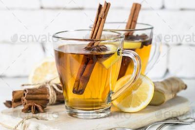 Autumn hot tea with lemon and spices
