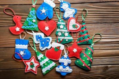 Assorted handmade rustic felt Christmas tree decorations wooden