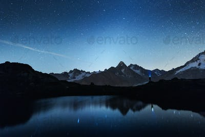 Picturesque night view of Chesery lake in France Alps