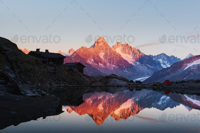 Colourful sunset on Lac Blanc lake in France Alps