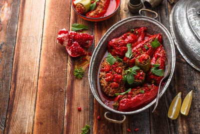 Rice stuffed vegetables in tomato sauce, top view, copy space