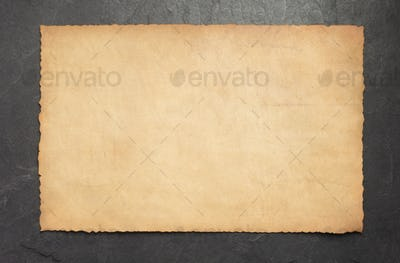old retro aged paper parchment on slate