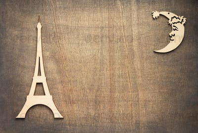 wooden eiffel tower toy at plywood background