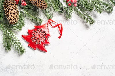 Christmas background with fir tree and cones on white  backgrou