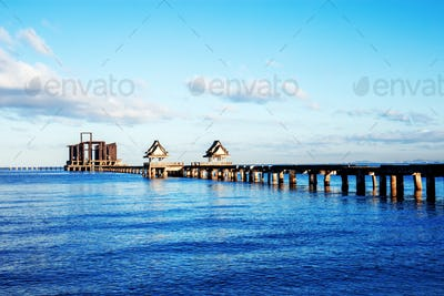 Bridge on sea at blue sky