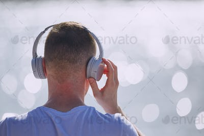 Young man with headphones listening