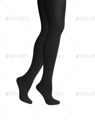 Woman's legs in black isolated on white background