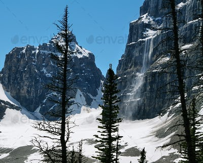 Small avalanche in snow capped mountain
