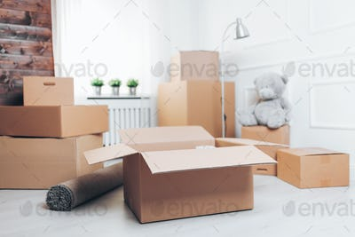 Moving concept. Room with cardboard boxes