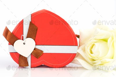 Close up white rose and heart shaped box on white_-3