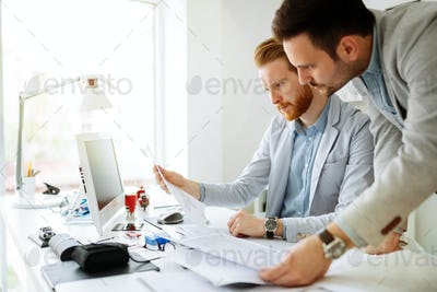 Coworkers planning startup goals