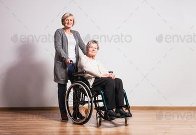Studio portrait of a senior women in wheelchair.