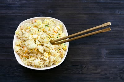 top view of portion of Fried Rice with chopsticks