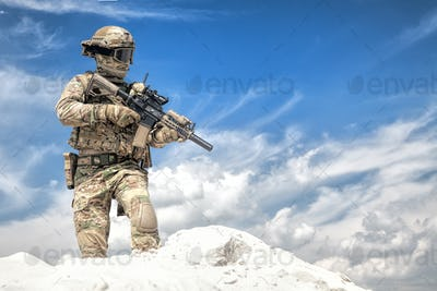 Airsoft player witt gun taking part in war games