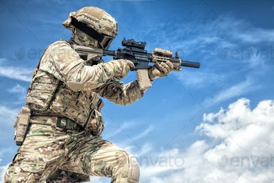 Equipped airsoft player aiming with service rifle