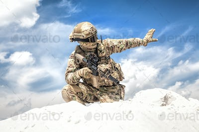 Equipped airsoft player showing halt hand signal