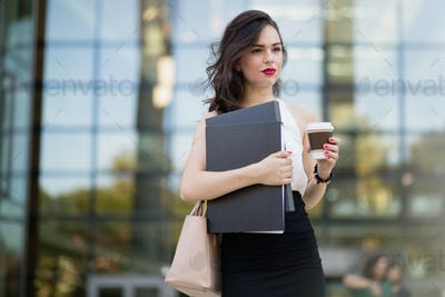 Busy businesswoman outdoors