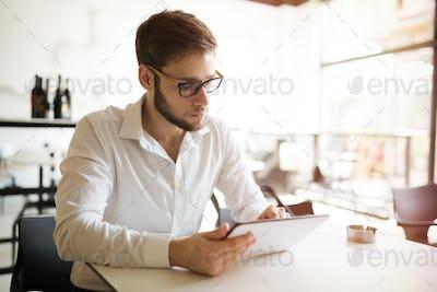 Busy businessman working in restaurant