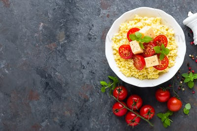 Millet porridge with tomatoes and cheese