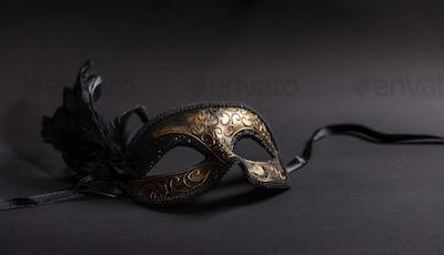 Carnival mask with feathers  on black background