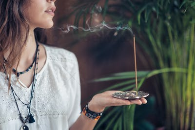 Incense Stick. Caucasian Woman Enjoying Aroma Stick
