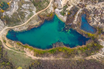 Drone view of industrial opencast mine filled with water. Aerial shot of artificial lake