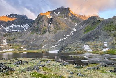 Sunlight Illuminates Mountain Ridge