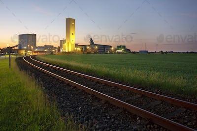 Railroad Track To Salt Mine At Dusk