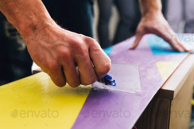 man is scratching and scrabing a snowboard