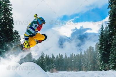 snowboarder is jumping very high