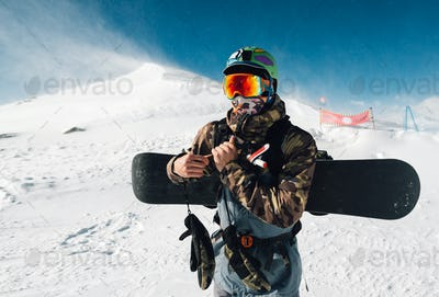 man stay with snowboard equipment