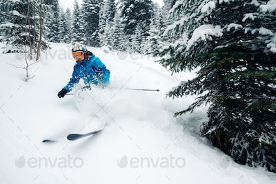 girl with special ski equipment is riding and jumping very fast in the mountain forest