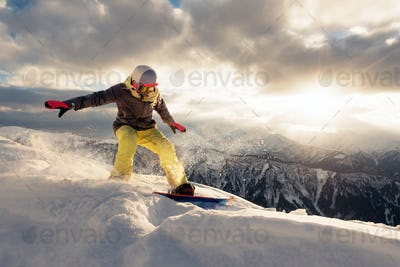 snowboarder is riding on the sunset