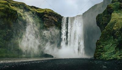 Landscape view of Skogafoss waterfall in cool colors, Skogar, Iceland