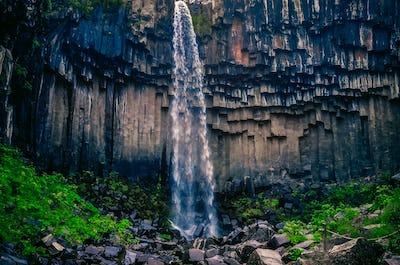 Landscape view of beautifol Svartifoss waterfall and volcanic rock walls, Iceland