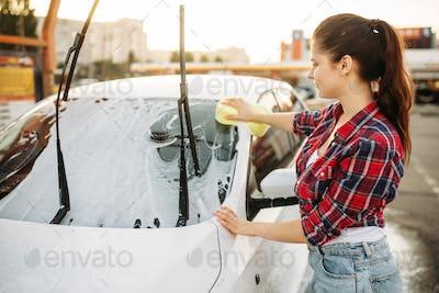 Woman on self-service car wash, carwash process