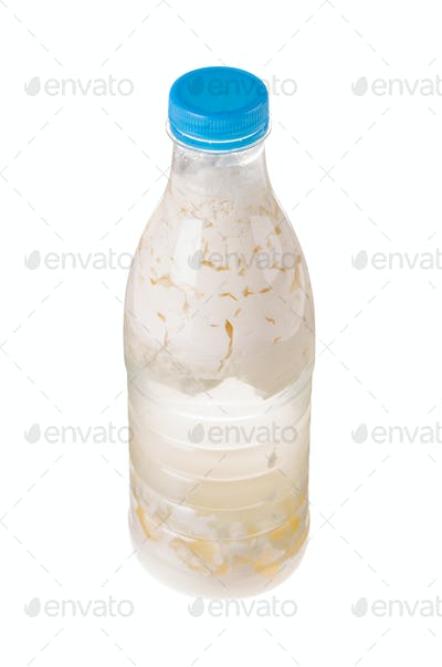 Sour milk in a plastic bottle.