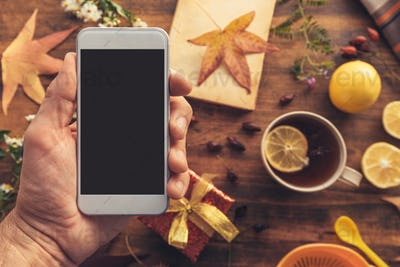 Smartphone mock up with autumn season decoration