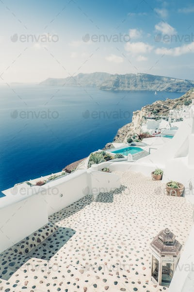 Scenic view of bright houses and pathway in romantic cycladic village, Greece