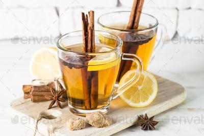 Autumn hot tea with lemon honey and spices